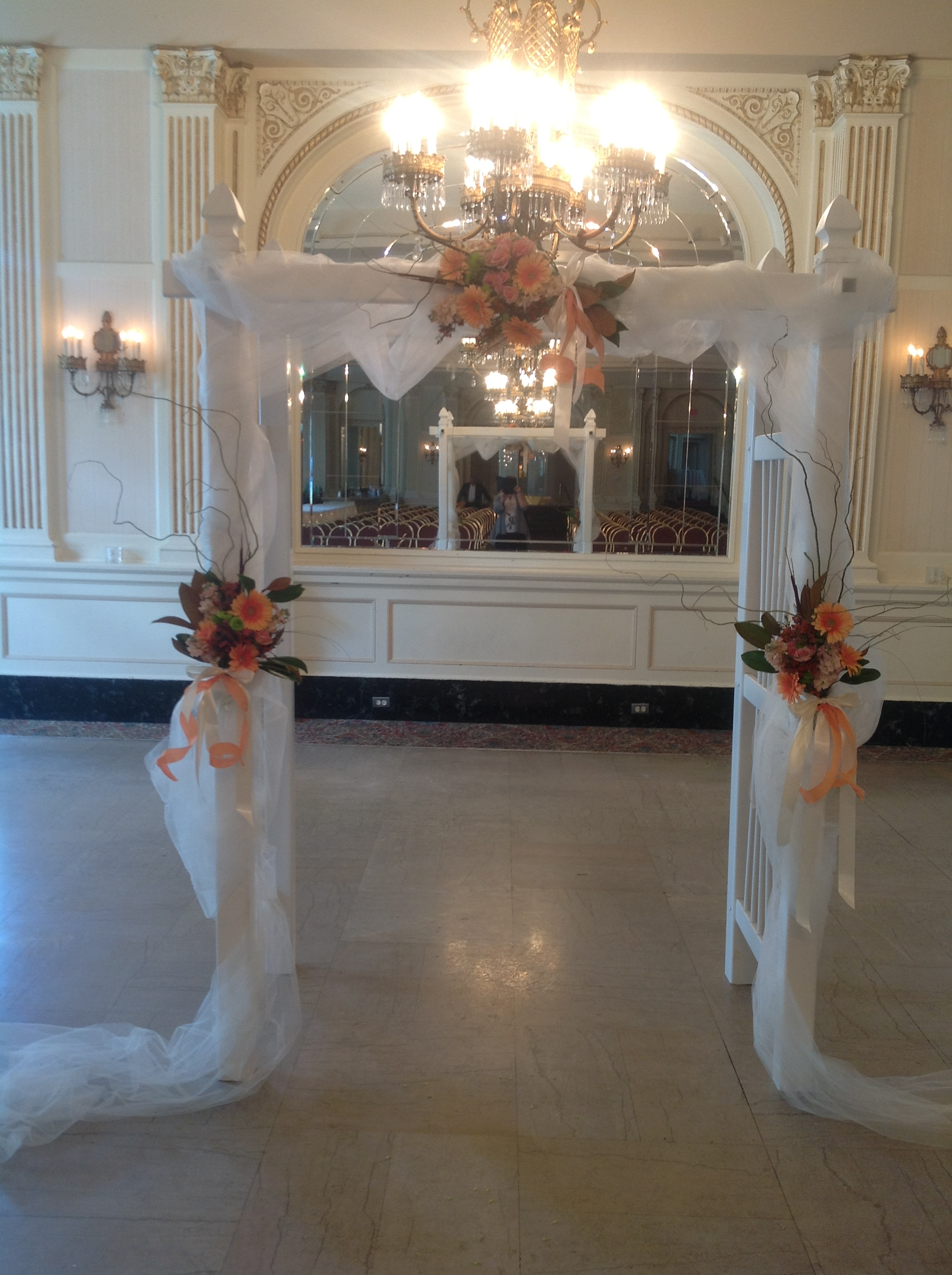 How to decorate your ceremony your local florist with locations belaire flowers on wedding arch junglespirit Choice Image